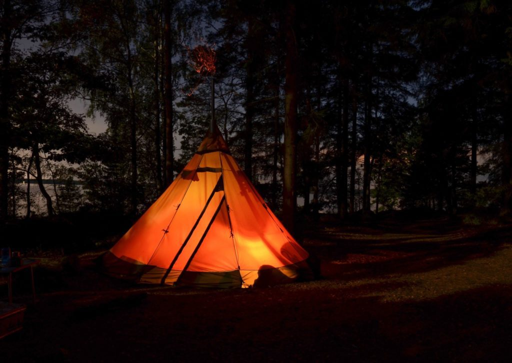 glowing camp at night